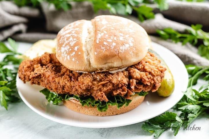 A spicy chicken sandwich on a hamburger bun.