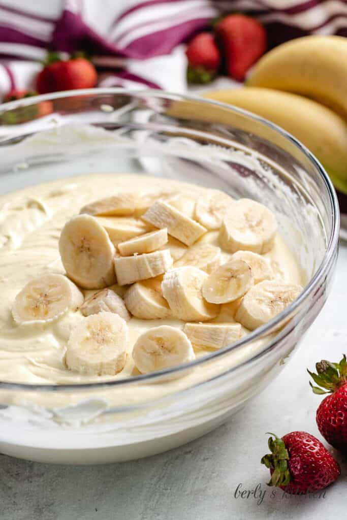 Fresh banana slices added to the bowl.