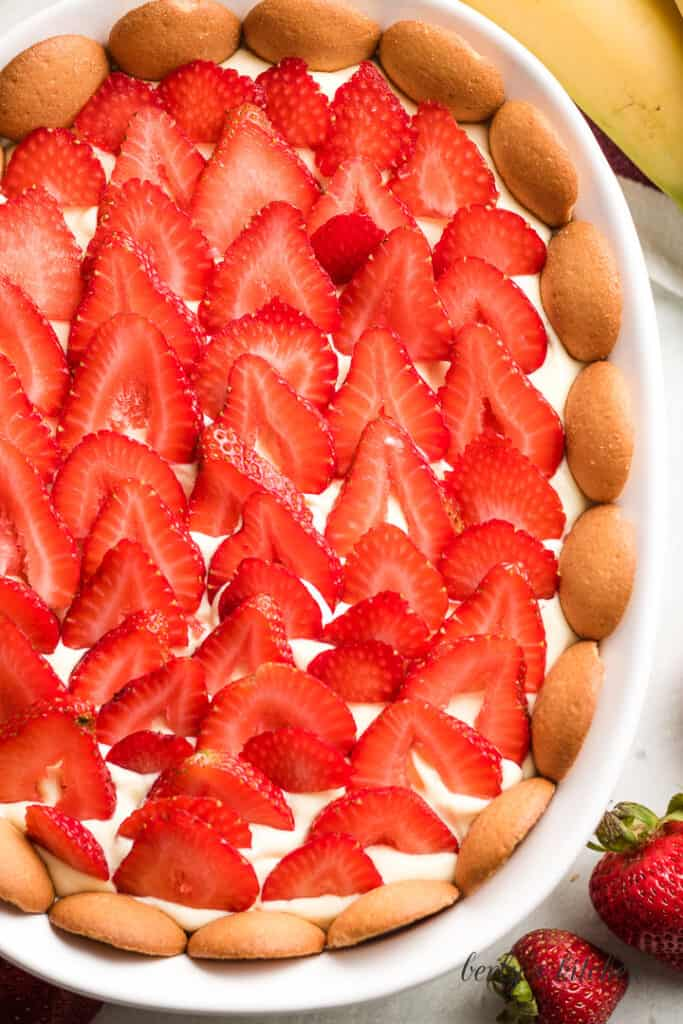 Sliced fresh strawberries on top of the pudding.