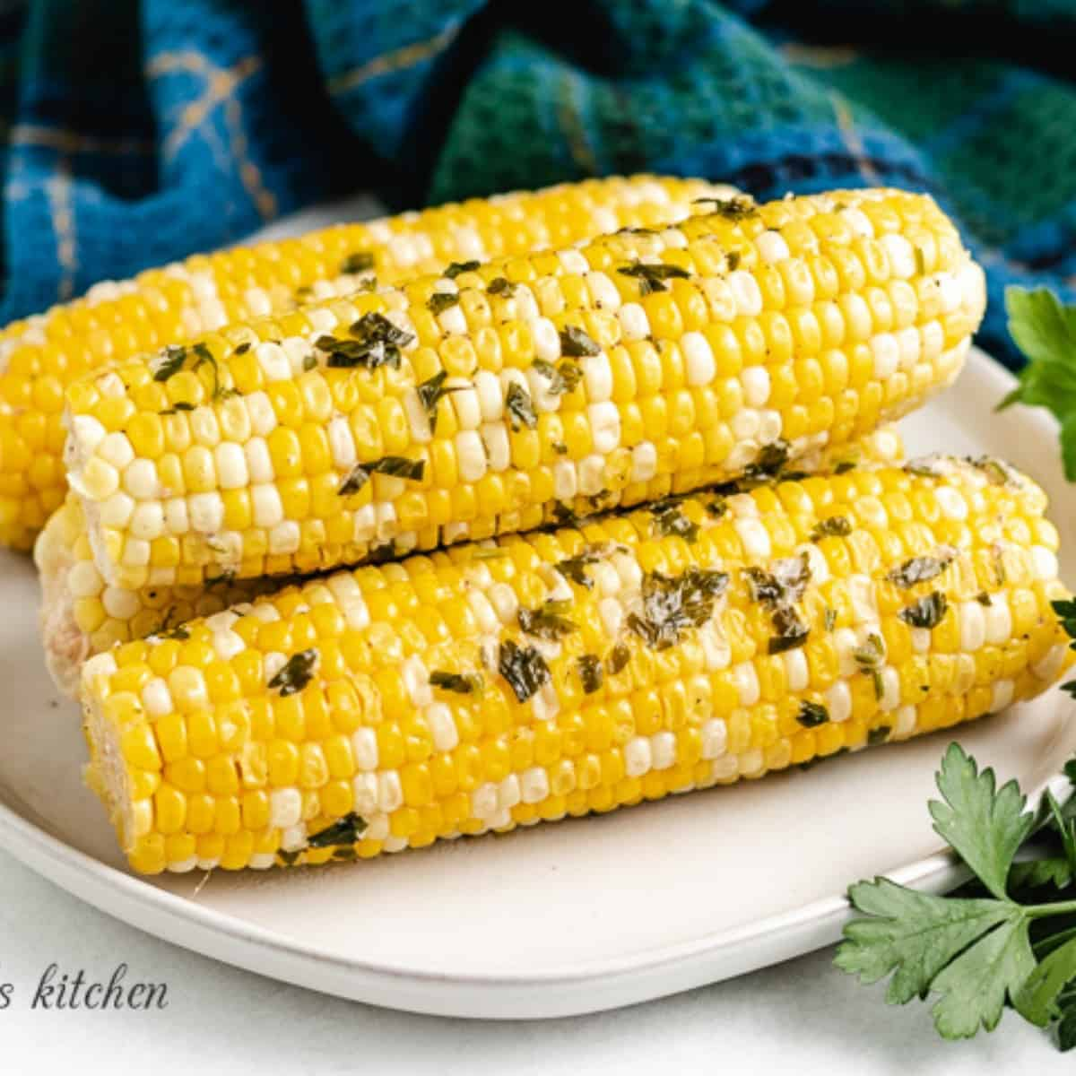 The grilled corn on the cob on a plated.