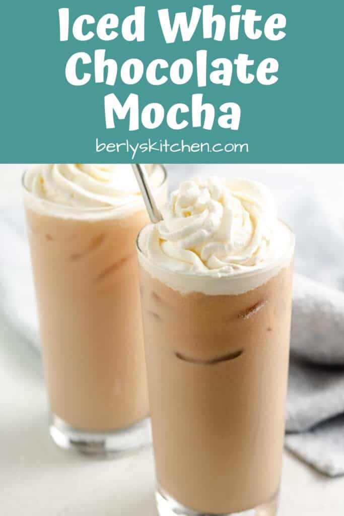 Two iced white chocolate mochas topped with whipped cream.