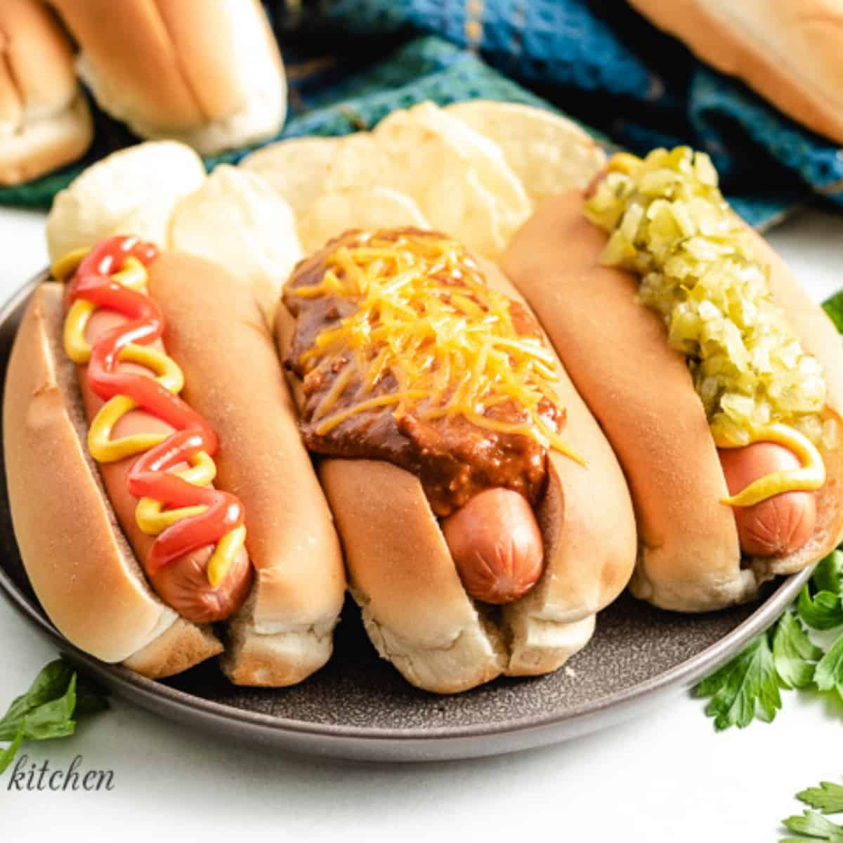 The finished Instant Pot hot dogs with condiments.