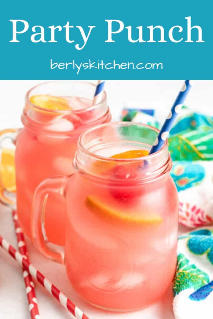 Tropical vodka punch served in mugs with colorful straws.