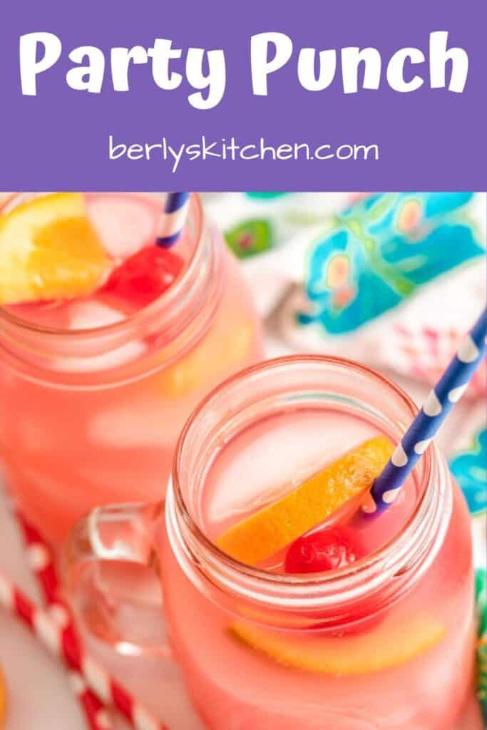 Tropical vodka punch garnished with fresh fruit.