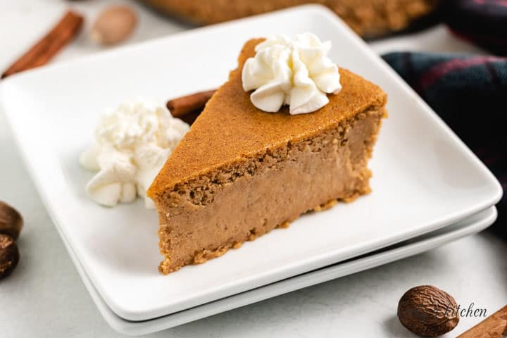 The pumpkin cheesecake served with whipped cream.