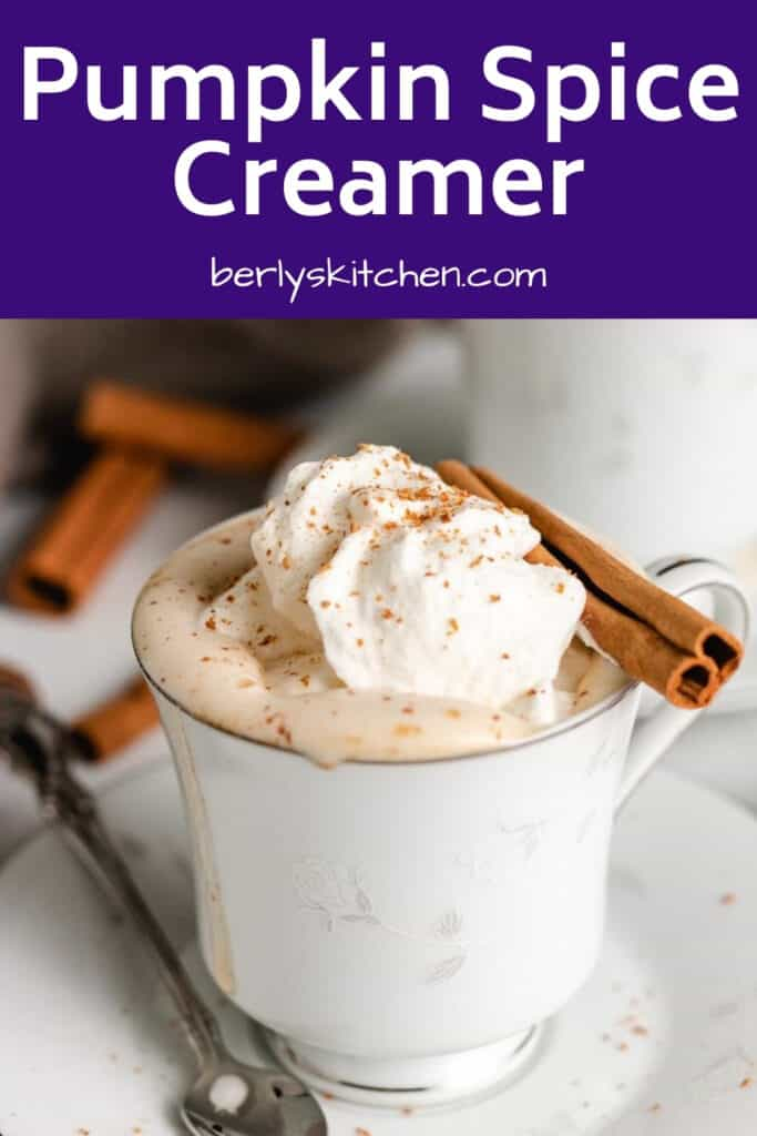 Coffee flavored with pumpkin spice creamer and garnished with a cinnamon stick.