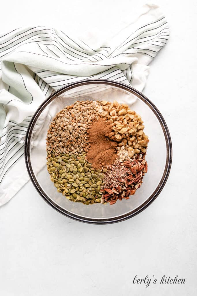 Oats, spices, and other ingredients in a mixing bowl.