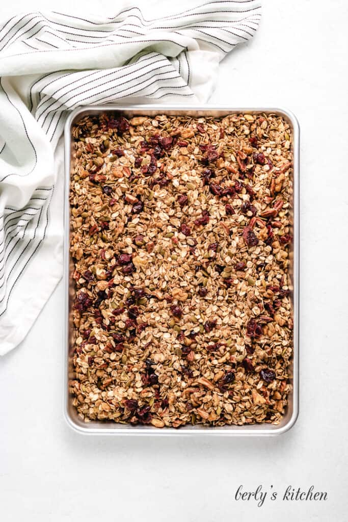 Toasted granola cooling on a sheet pan.