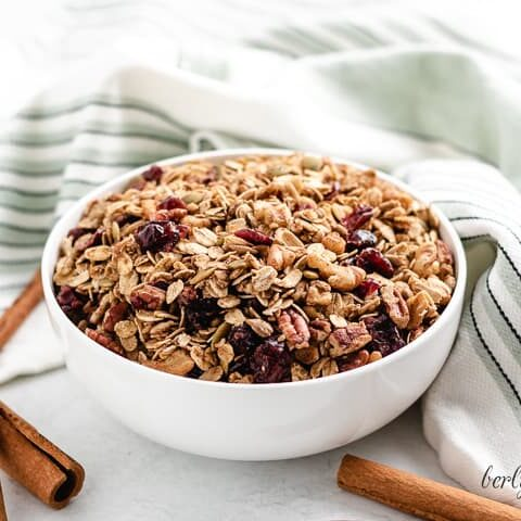 A small bowl filled with pumpkin spice granola.