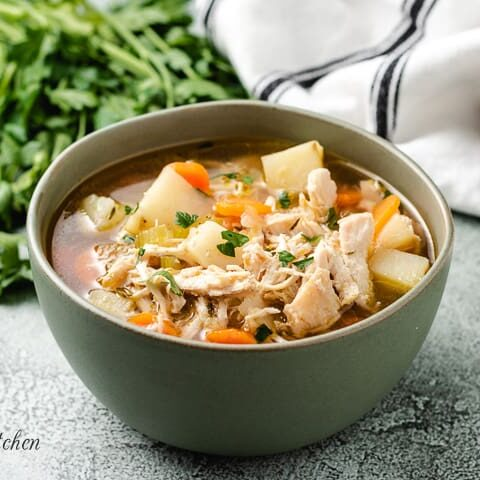 A serving of the chicken potato soup in a bowl.