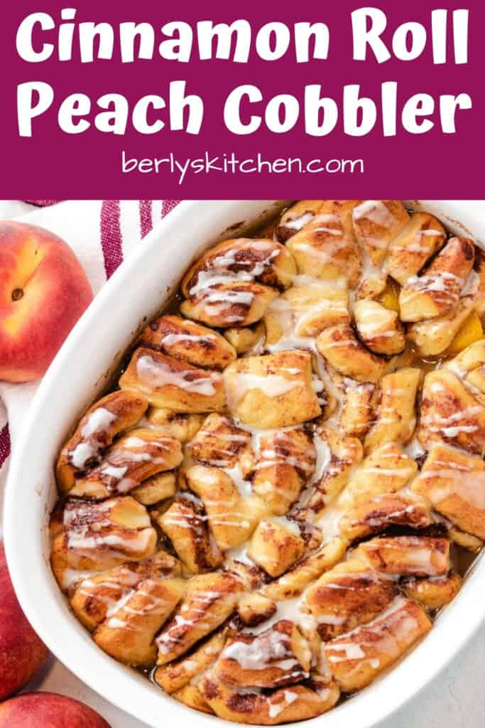 Cinnamon roll peach cobbler topped with vanilla icing.
