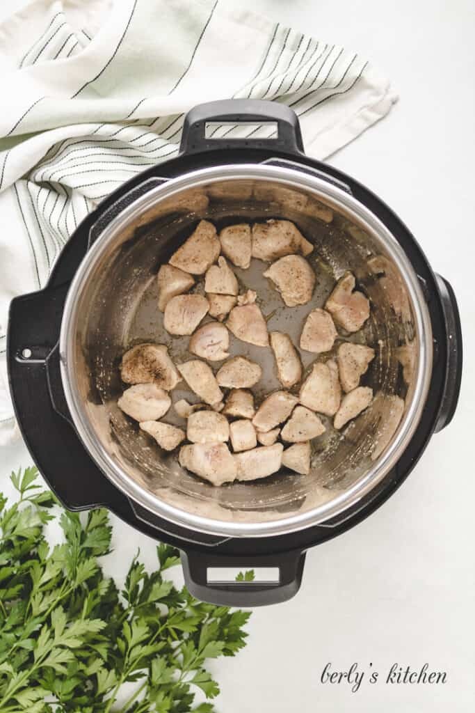 Chicken pieces in an Instant Pot.
