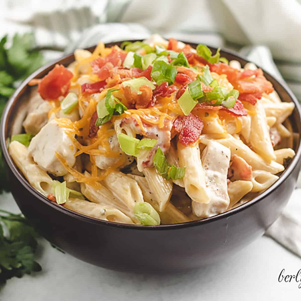 Brown bowl with chicken bacon ranch pasta.