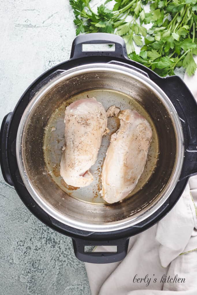 Sauteed chicken breasts in the Instant Pot.