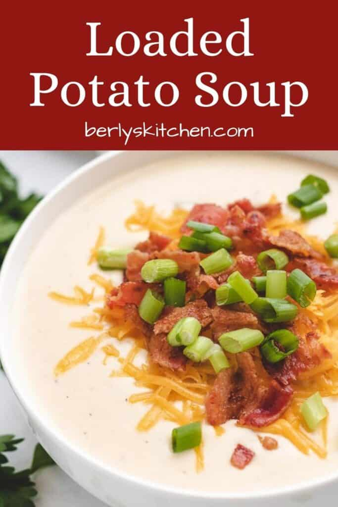 A bowl of loaded potato soup with bacon and cheddar.
