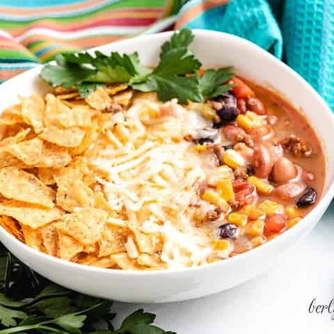 Stove top taco soup served with fresh cilantro and cheese.
