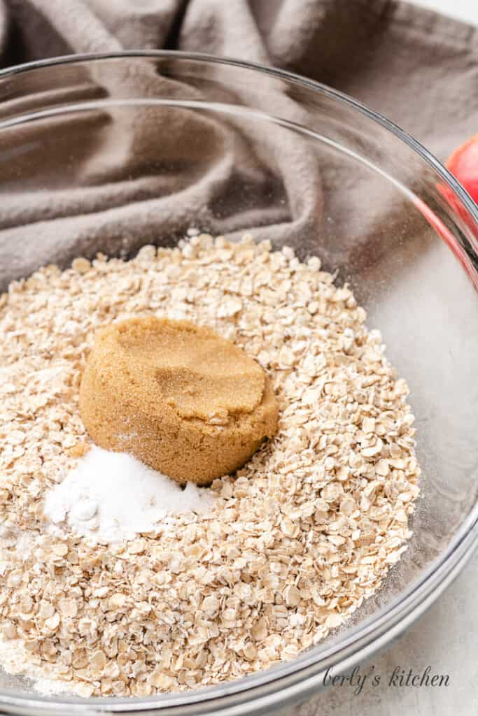 Flour, oats, and brown sugar in a mixing bowl.