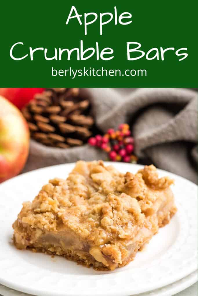 A fresh baked apple crumble bar on a plate.