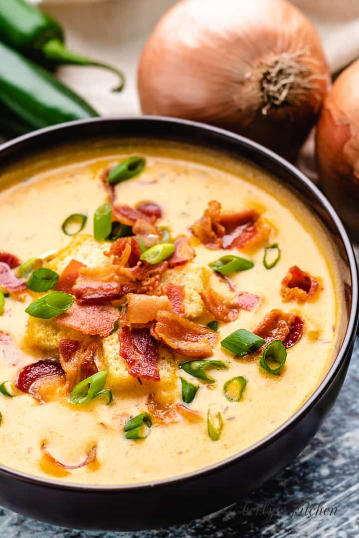 Diced green onions and crispy bacon atop the soup.