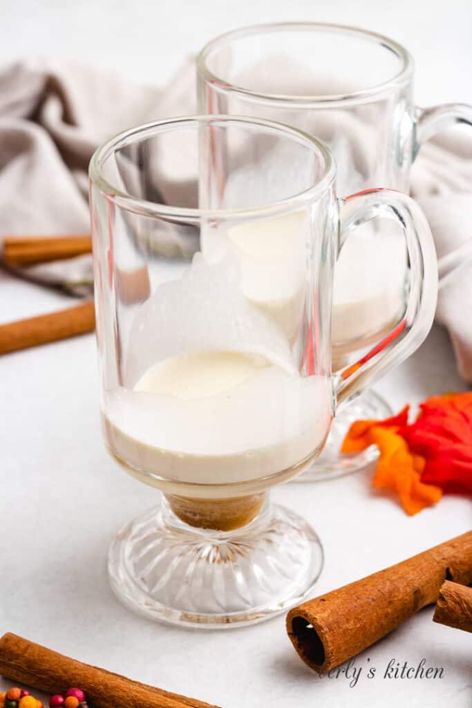 Heavy cream and brown sugar in a mug.