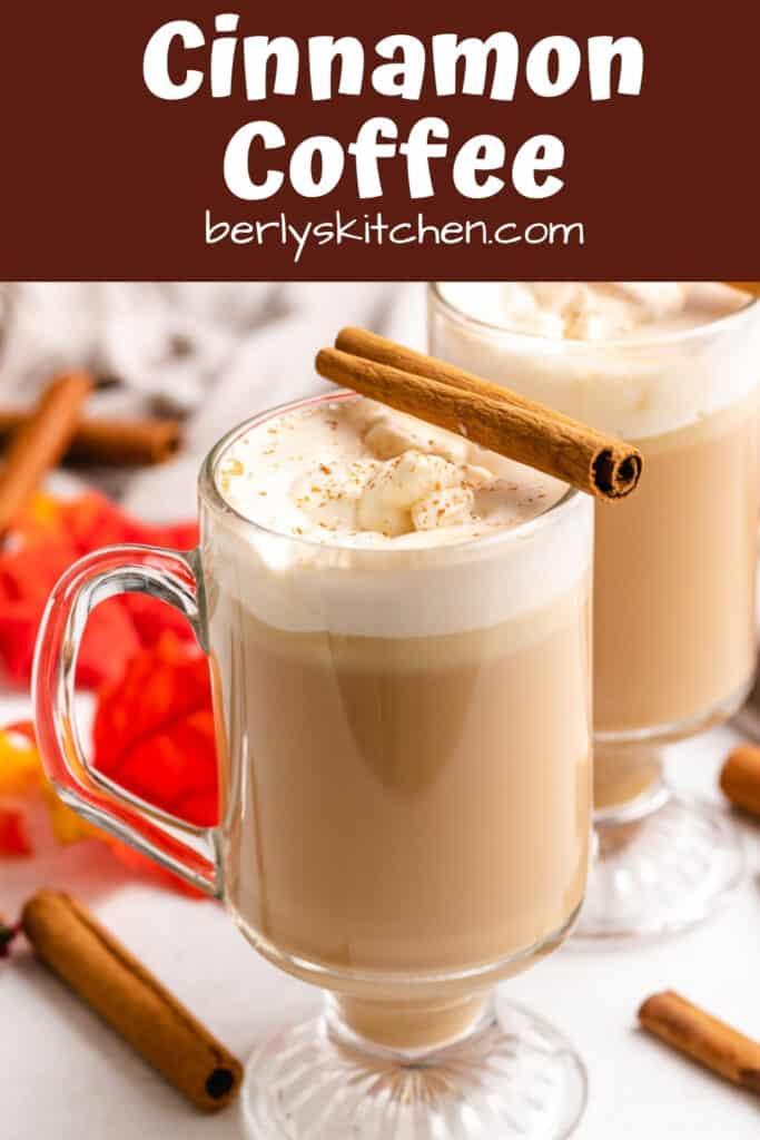 Two mugs of cinnamon coffee garnished with cinnamon sticks.