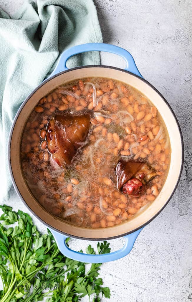 Canned pinto beans added to the broth.