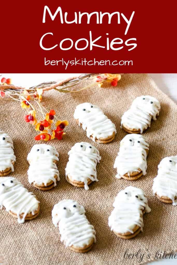 Nutter Butter mummy cookies on a sheet of burlap.