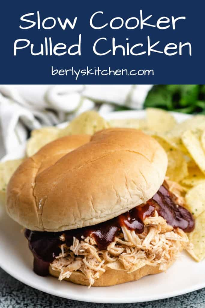 A slow cooker BBQ chicken sandwich with chips.