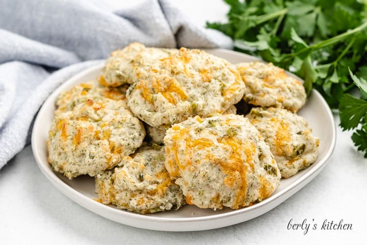 Cheddar dill biscuits served on a plate.
