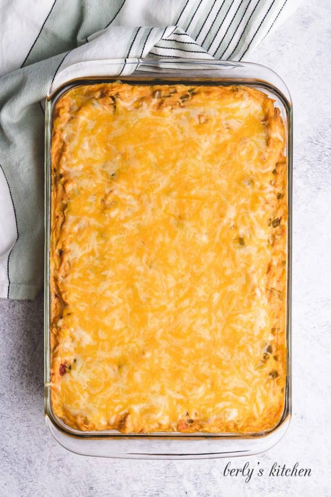 The casserole has baked and been topped with cheese.