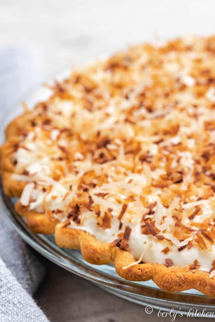 The whipped topping and toasted coconut added to the pie.