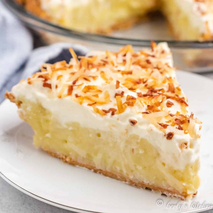 A slice of homemade coconut cream pie on a plate.