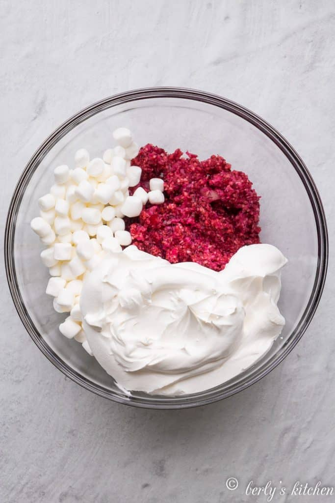 Cranberries, whipped topping, and marshmallows in a bowl.