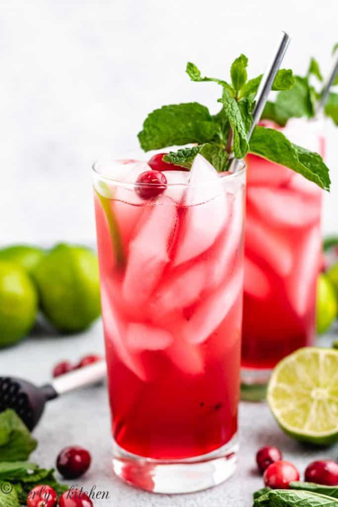 Cranberry cocktails served in collins' glasses.