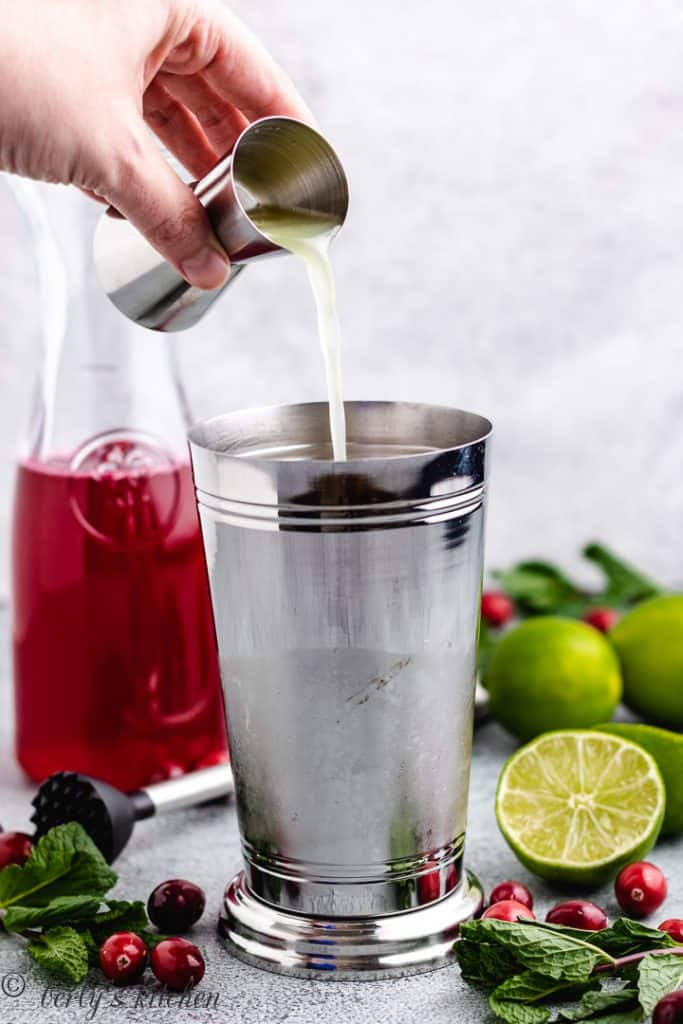 Lime juice being poured into a shaker.