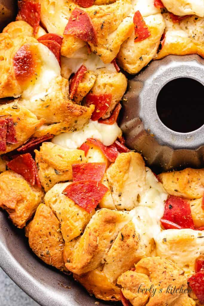 Top-down view of the fresh baked and cheesy appetizer.