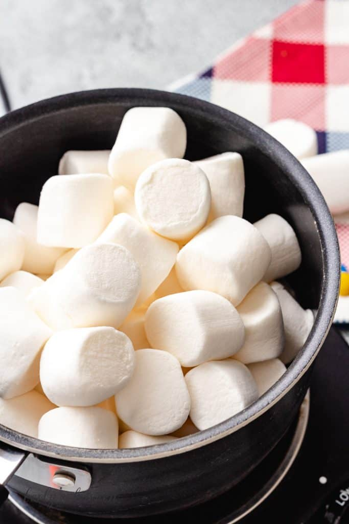 Large marshmallows in a saucepan.