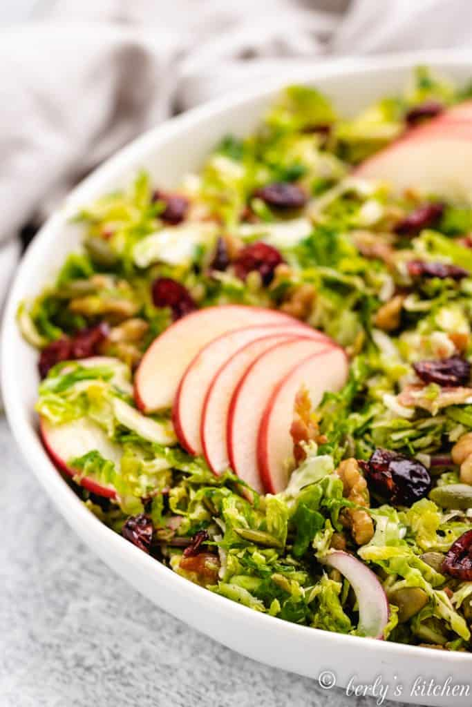 A close-up view of the apple-topped salad.