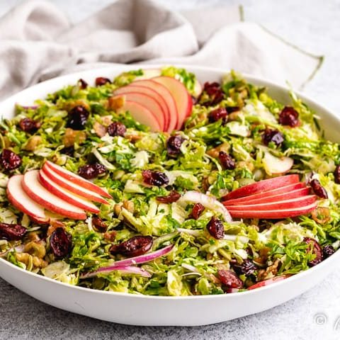The shaved brussel sprout salad served in a bowl.