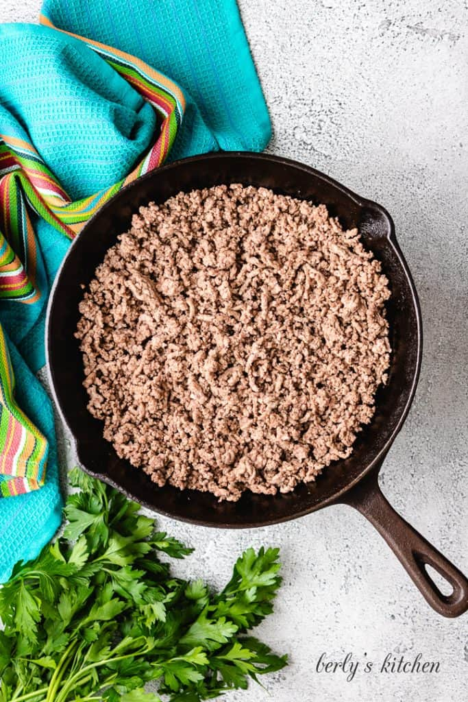 Cooked ground beef in a cast iron skillet.