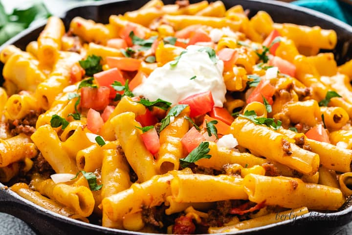 An up-close view of the taco pasta topped with sour cream.