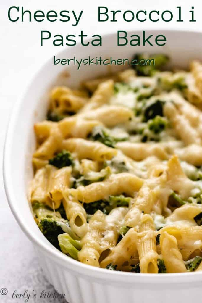 Broccoli cheese pasta bake in a white casserole dish.