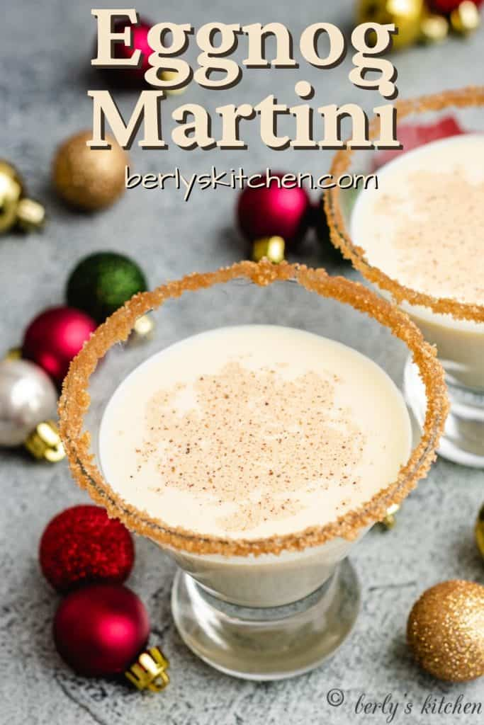 An aerial view of two eggnog martinis in decorated glasses.