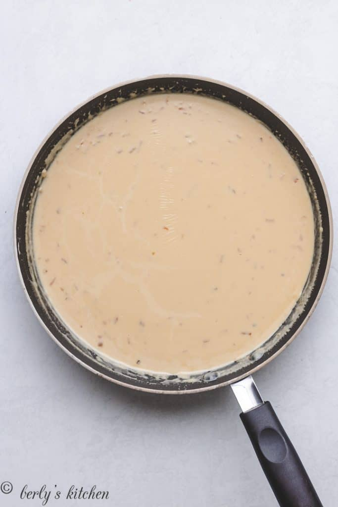 Butter, heavy cream, and soup mix in a skillet.