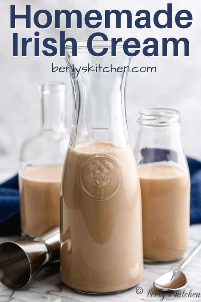 Homemade Irish cream stored in three glass containers.