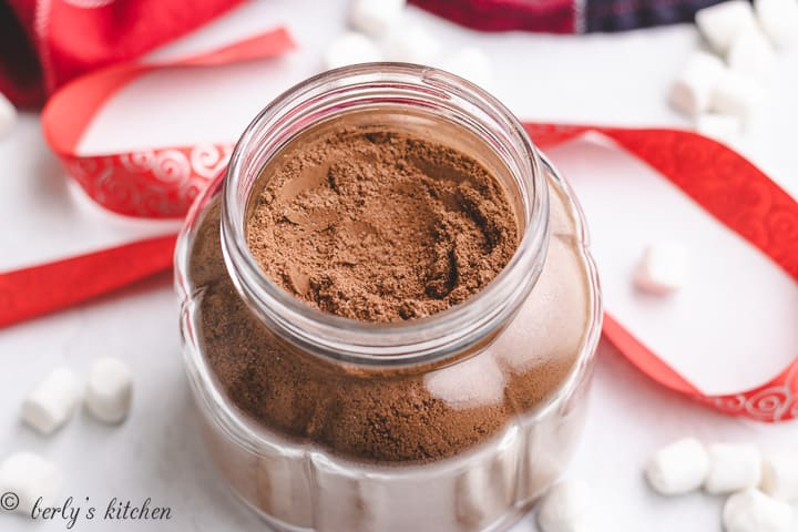 Homemade hot chocolate mix in a glass jar.
