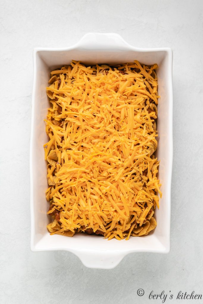 Cheddar cheese sprinkled over the chili and chips.