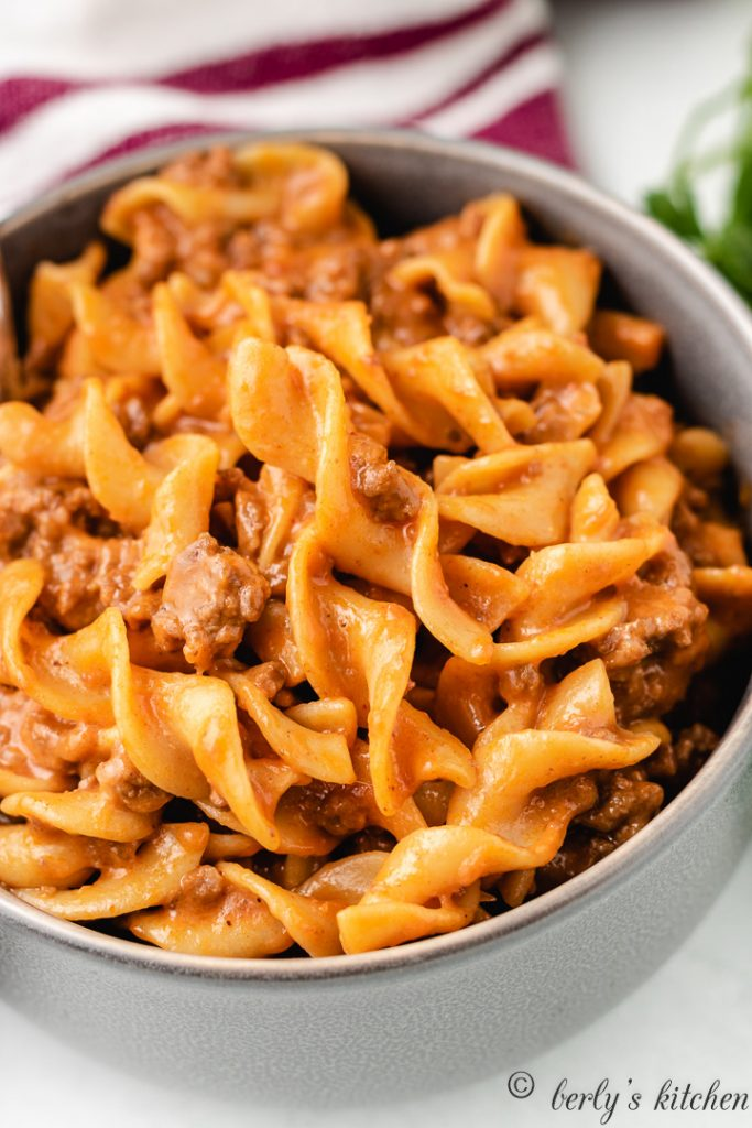 A top-down view of the cheesy beef pasta in a bowl.