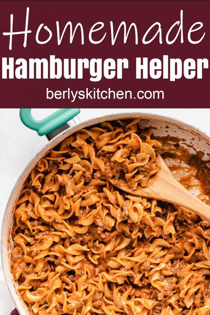Homemade hamburger helper cooking in a large skillet.