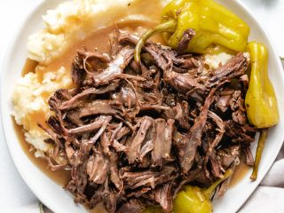Top down photo of Mississippi roast with mashed potatoes.